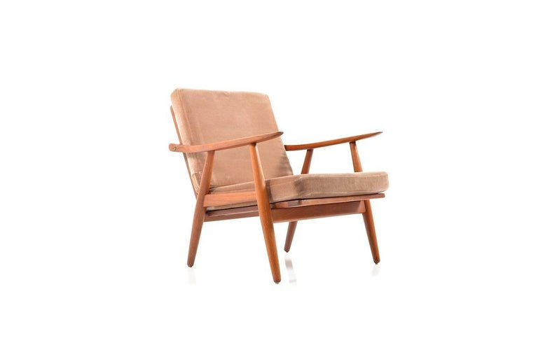 Early GE-270 teak wooden easy chairs by Hans J. Wegner. Designed in 1950s. Manufactured by GETAMA. Cushions in foam material with mud-colored mohair wool. Early production. Great Danish design by the icon Hans Wegner.
