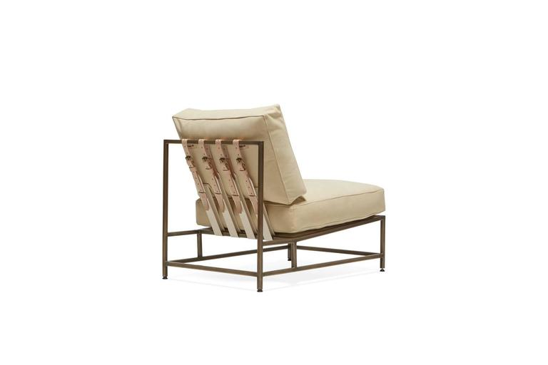 Sleek and refined, the Inheritance Chair is a great addition to nearly any space.   This variation is upholstered in a warm cream nubuck leather with a soft suede like touch. The foam seat cushions have been wrapped in down, allowing for a soft and