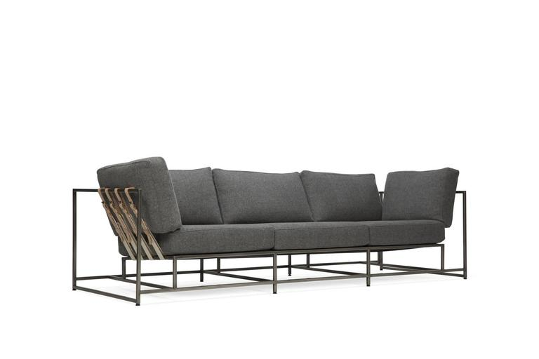 A soft and durable grey wool upholstery from US-manufacturer Faribault Woolen Mills, atop an antique nickel frame and supported by natural webbing and veg tan leather belts. Vintage pillows sold separately, inquire within.  This item is made to