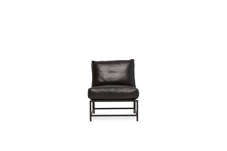 A part of our new leather collection, this chair has a blackened steel frame finish, black webbing and cognac leather belts and upholstery of soft black vegetable tanned leather.