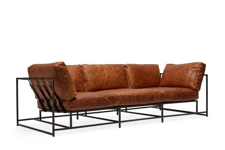 A new sofa in our leather series, this version of the Inheritance Collection sofa has a rich cognac leather upholstery from Moore & Giles atop a blackened steel frame with black cotton webbing and burnished cognac leather belts. vintage indigo
