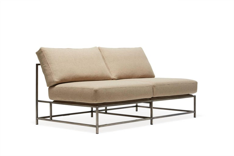 The Inheritance Loveseat is great as a standalone piece, or as part of a modular sectional with other Inheritance designs.  This variation is upholstered in a soft tan wool. The foam seat cushions have been wrapped in polyfiber, allowing for a soft