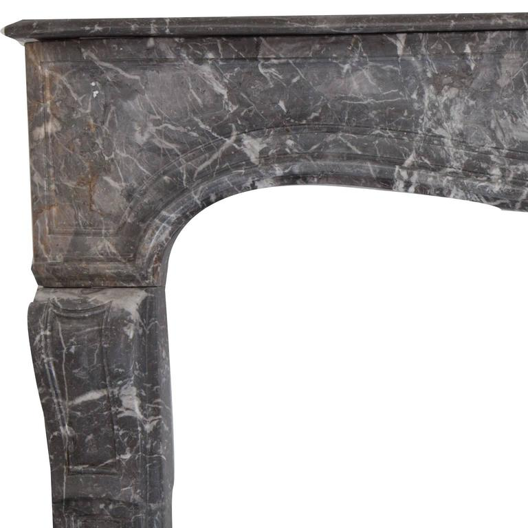 Rare 18th century antique French Louis XVI fireplace mantel. Hand-carved in desirable St Anne's marble. Delicately carved recessed Jambs and Frieze; with elegantly carved centre shell, together with moulded detailed shelf.   Full