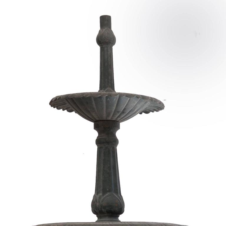 Vintage green cast iron three-tier heron reclaimed fountain. This is a wonderful Victorian style three-tier fountain. There are three heron's surrounding the base. Taken from an English manor house. This comes in sections for ease of