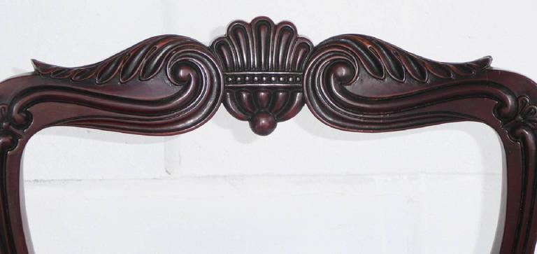 For sale is a set of six George IV carved mahogany dining chairs in the manner of gillows. Each chair has a shaped and moulded backs with carved anthemonand leaf scroll crest rails, with a carved splat with carved circular paterae, with drop in