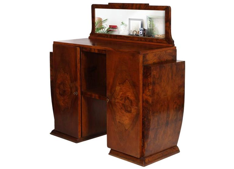 Code: FP07 Sculptural All original Art Deco Gaetano or Osvaldo Borsani credenza , sideboard or console early 20th century in walnut and burr walnut. Small rectangular shaped mirror. Two doors with interior shelf.  Restored and polished with wax.