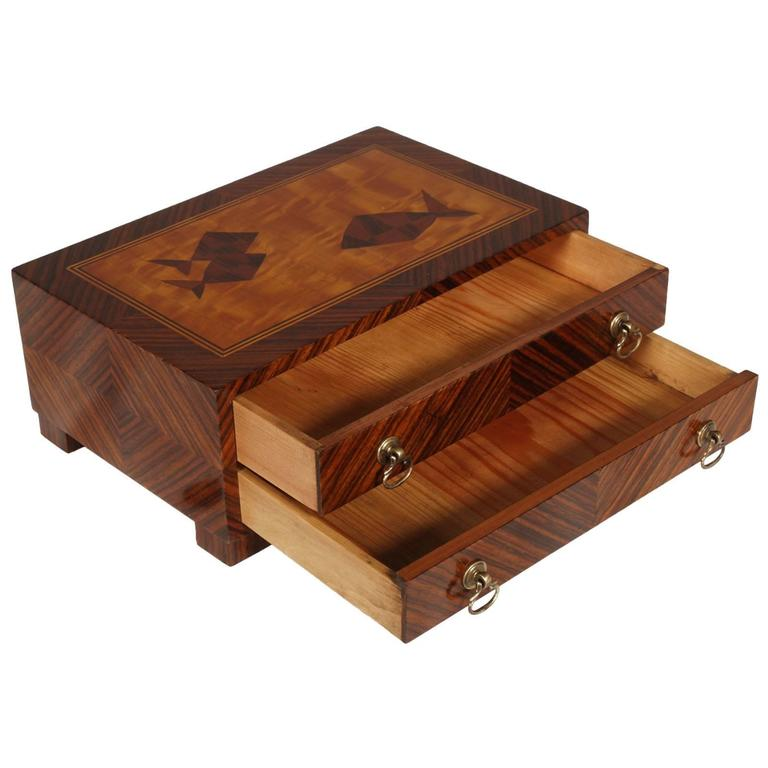 Code: FT02 refined veneered jewelry box with precious rosewood striped herringbone, two drawers with brass handles. Top with maple veneer inlay figures. Finishing with shellac.  Measure in cm H 12, L 30, P 19 in inches H 4.80, L 12.00