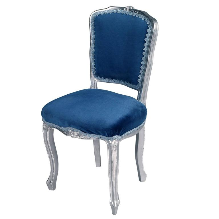 Code: FA41 Elegant Venetian Baroque side chairs in walnut hand-carved and silvered with new blue velvet upholstery.