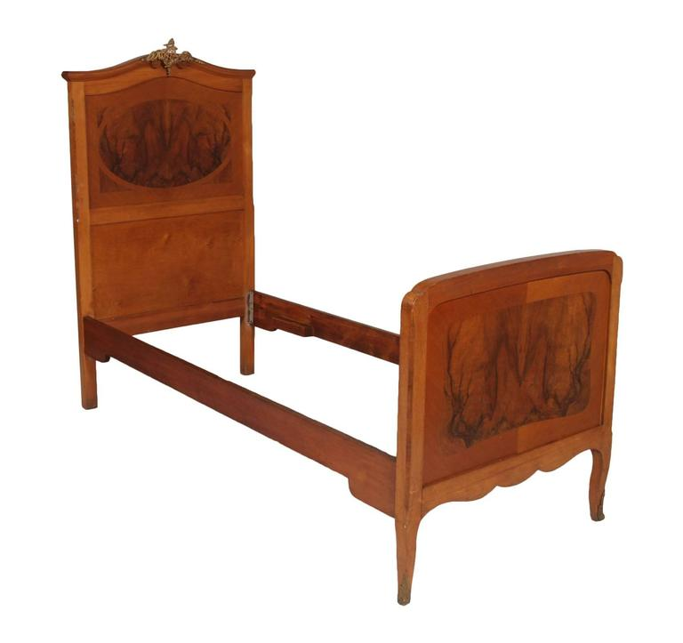Early 20th century, 1920s antique Italian Art Nouveau pair of beds in cheerywood and burl walnut with golden bronze adornments