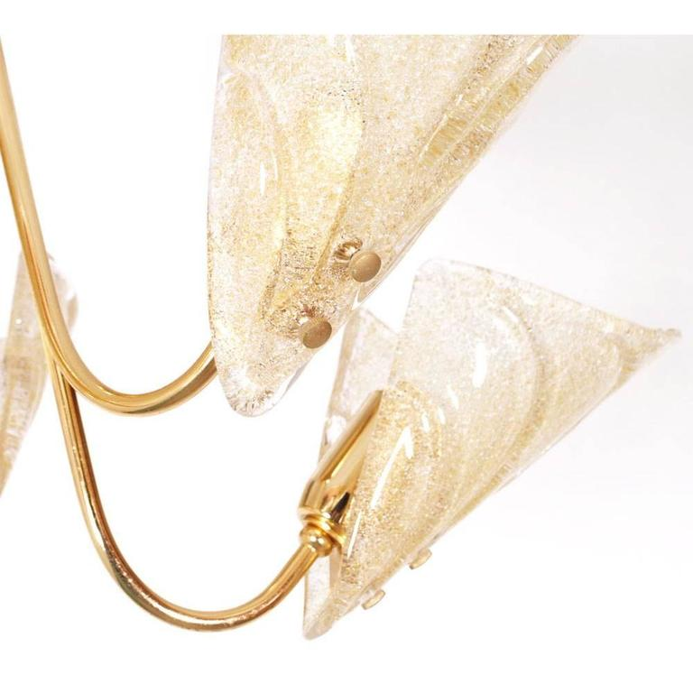 1950s Mid-Century Modernchandelier, six-light, Murano glass leaves by Carlo Nason for Mazzega The six leaves are molded and fused with clear and dark amber glass splashes.  The supporting structure of gold-plated brass.  The chandelier has been