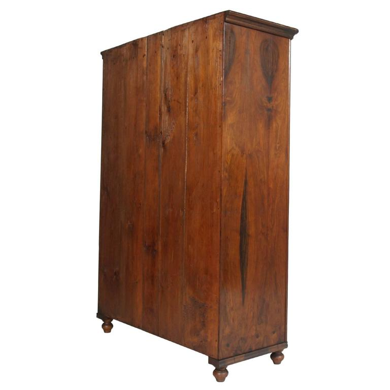 19th century Austrian Biedermeier wardrobe cabinet in solid walnut restored polished wax. With coat hooks and stick