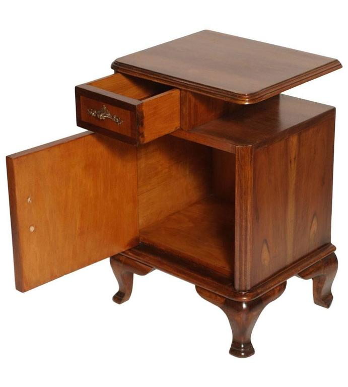 Very elegant 1920s Italian Baroque bedside table, nightstand, in massive walnut and walnut applied, restored and finished with shellac and wax.  Measures cm: H 66 x W 47 x D 37.