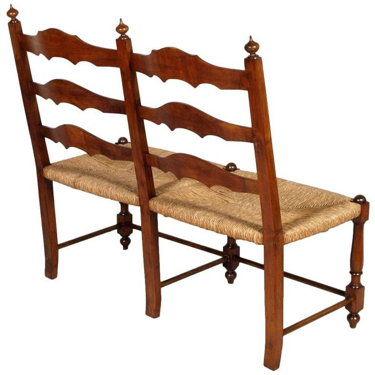 Antique country bench seat, in turned wood, with straw seat of the early 20th century  Measures cm: H 45\105 x W 118 x D 55.