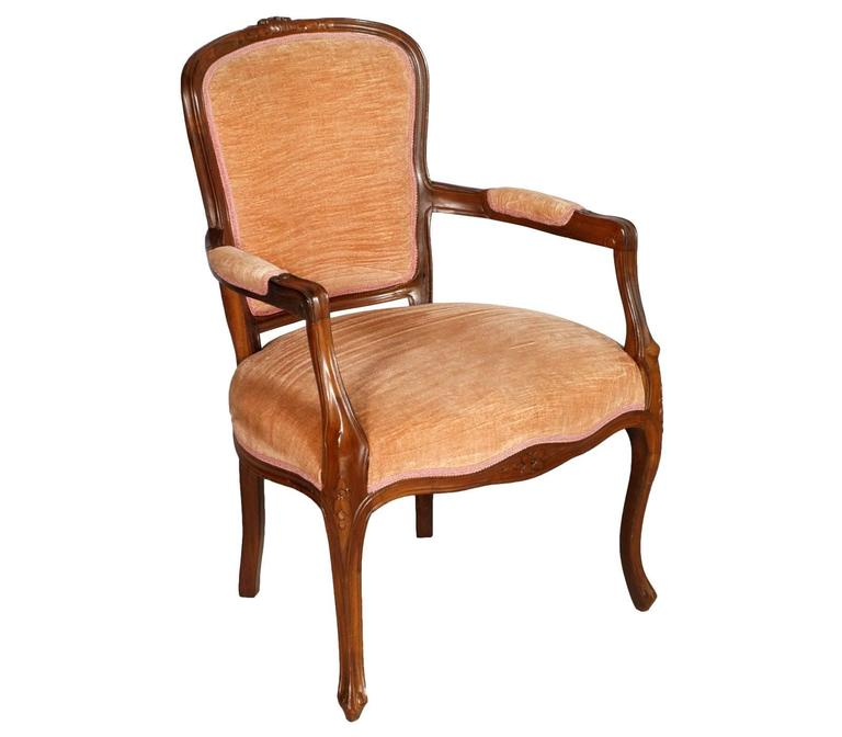 Italian Early 20th Century pair Art Nouveau armchairs in hand carved Walnut, polished with wax. Original velvet upholstery still usable  Measures cm: H 87\42 x W 62 x D 64.