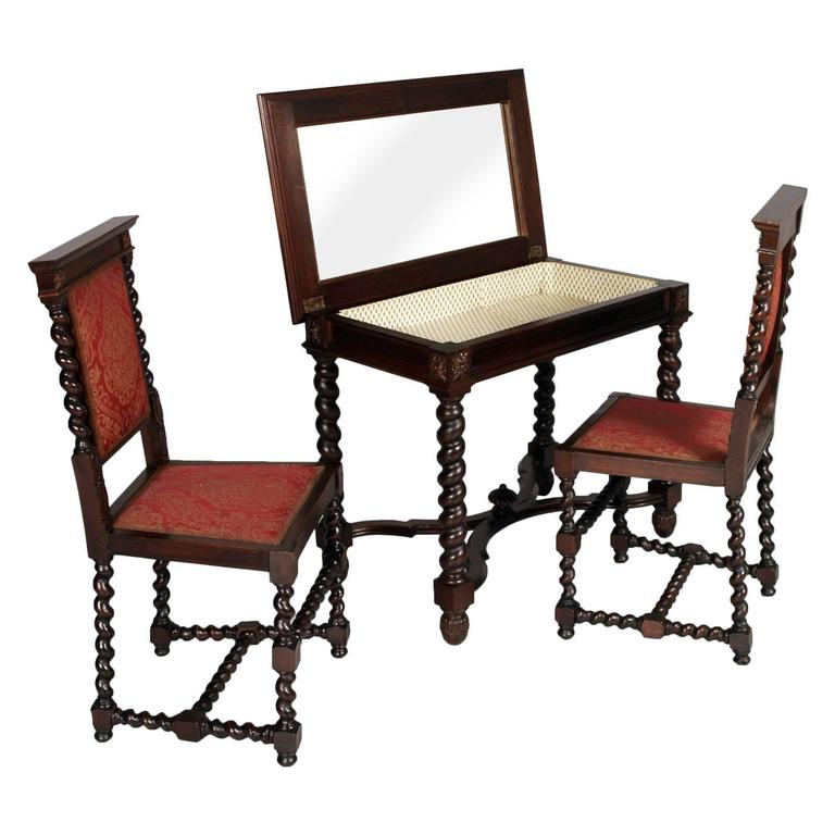 Antique renaissance Vanity, desk with mirror and two chairs in carved ebonized walnut.