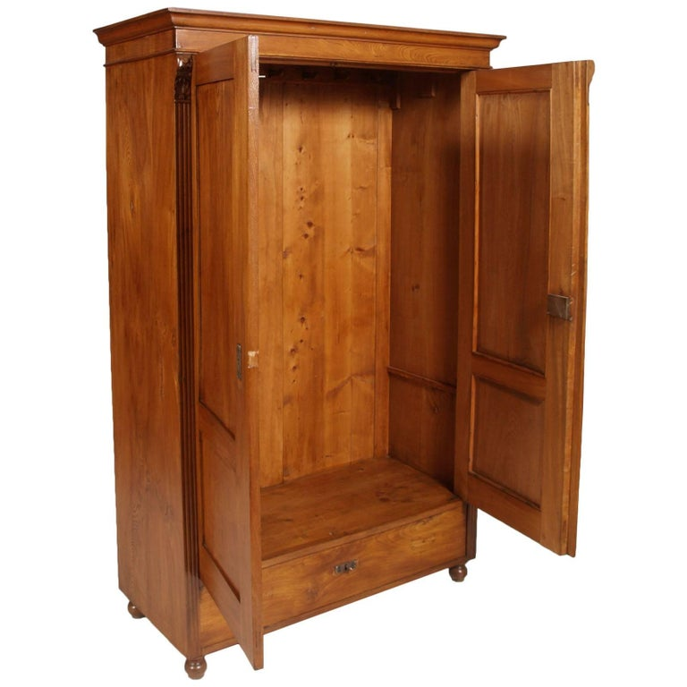 1850s antique neoclassic cabinet cupboard in solid elmwood restored and polished to wax  Measures cm: H 184, W 120, D 54.