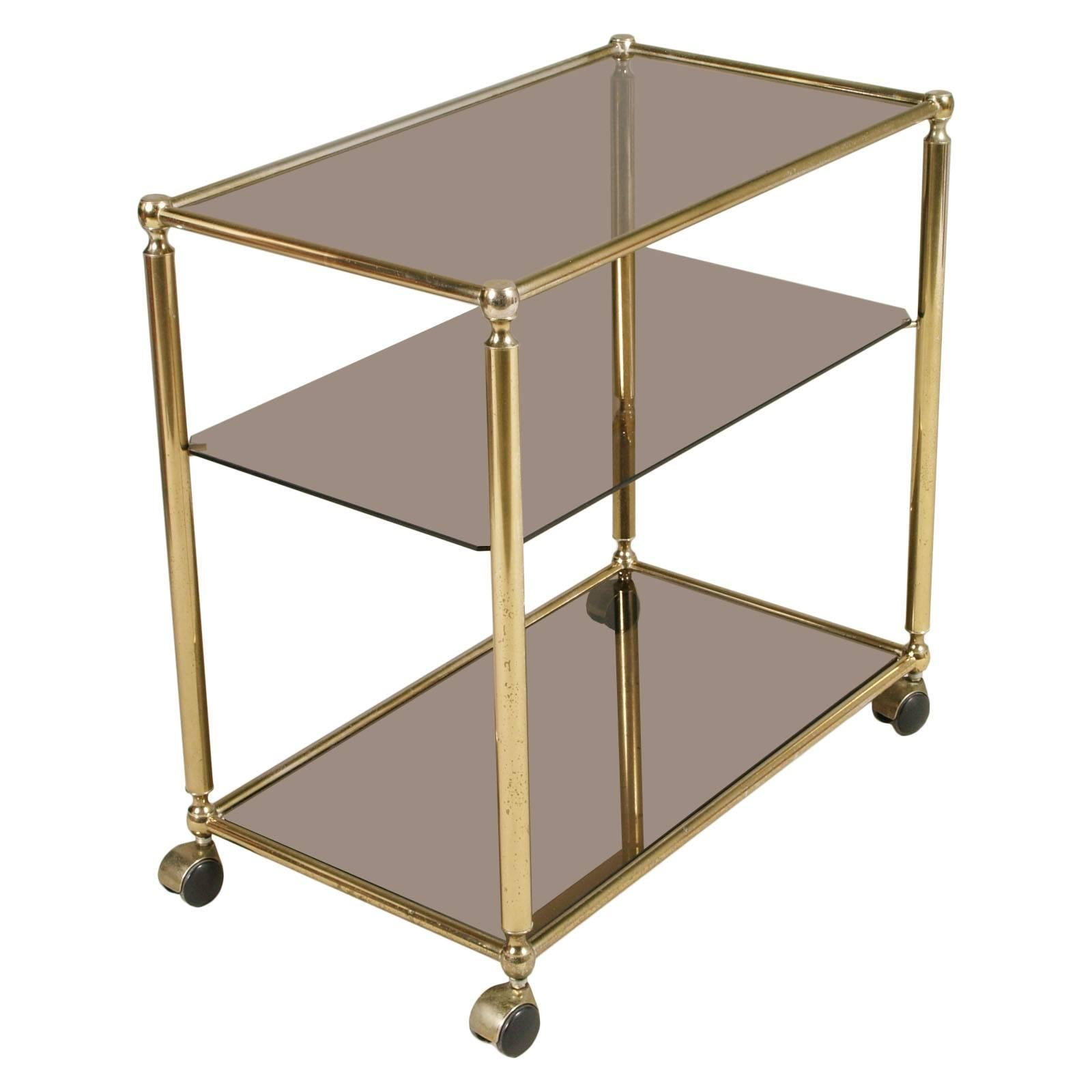 Mid century modern bar cart in brass with three shelves in crystal fumè for sale at 1stdibs
