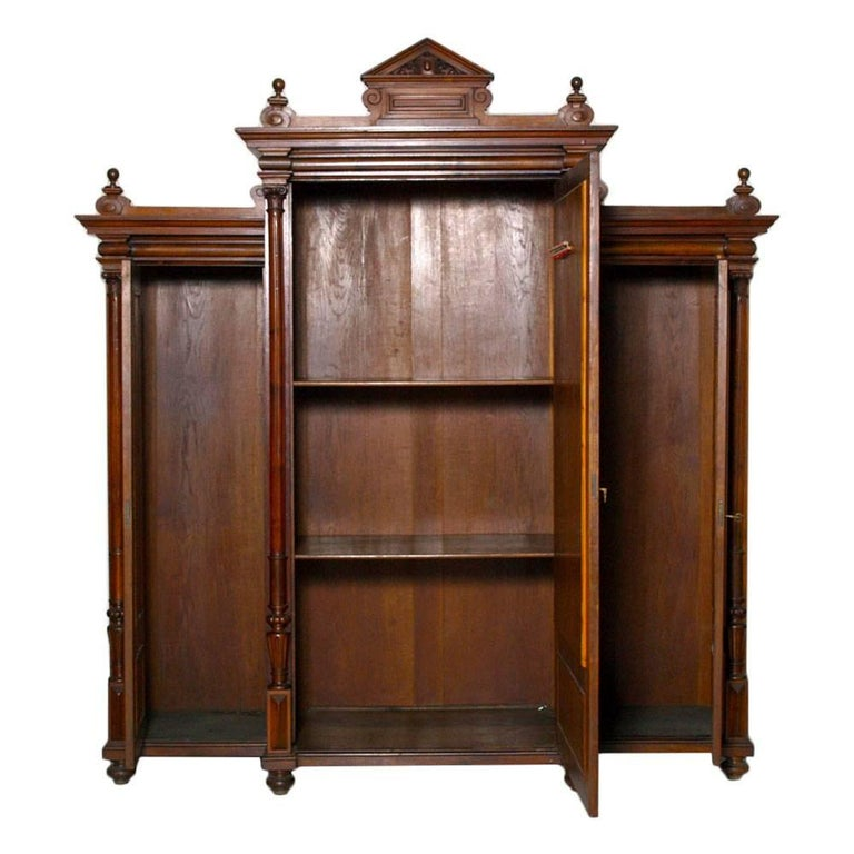 Italian last 19th century neoclassic wardrobe bookcase, all solid walnut and burl walnut and solid oak interior. Restored and polished to wax. Elegant and sturdy wardrobe can also be used as an important bookcase.  Measures cm: H 234 x W 247 x D