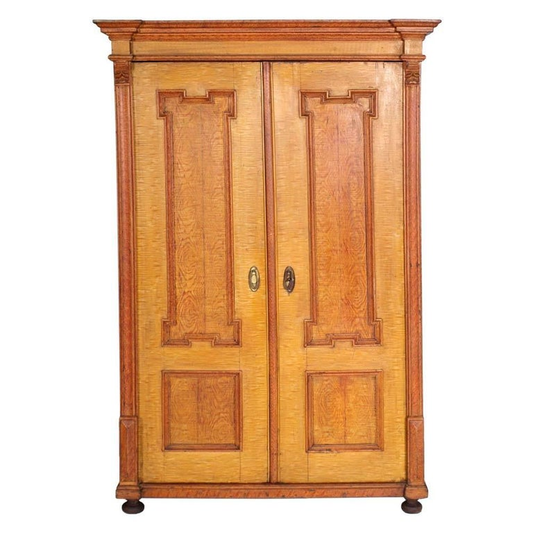 Antique Austrian Neoclassic Wardrobe Cupboard in Massive Wood Laquered Faux Wood For Sale