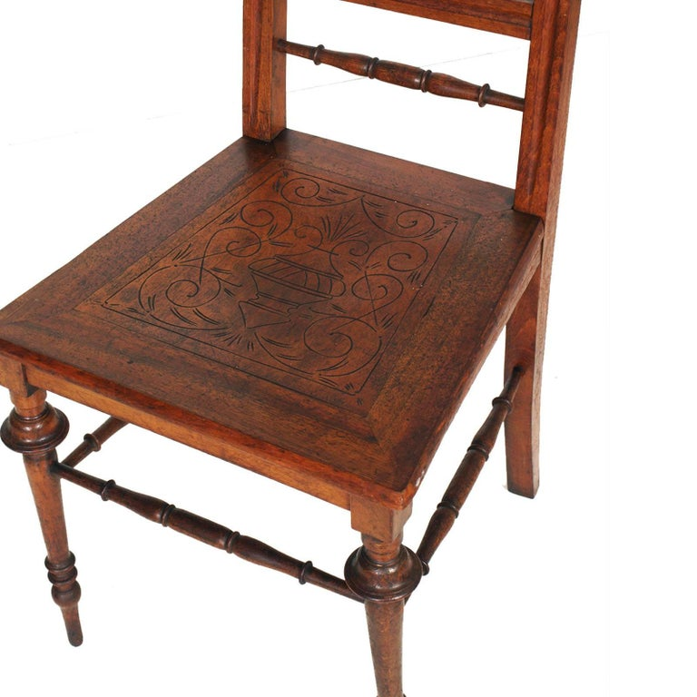Elegant Mid-19th century Chiavarine side chairs in turned walnut and with hand-carved seat, restored and finished to wax  Measure cm: H 101\47 x W 45 x D 45.