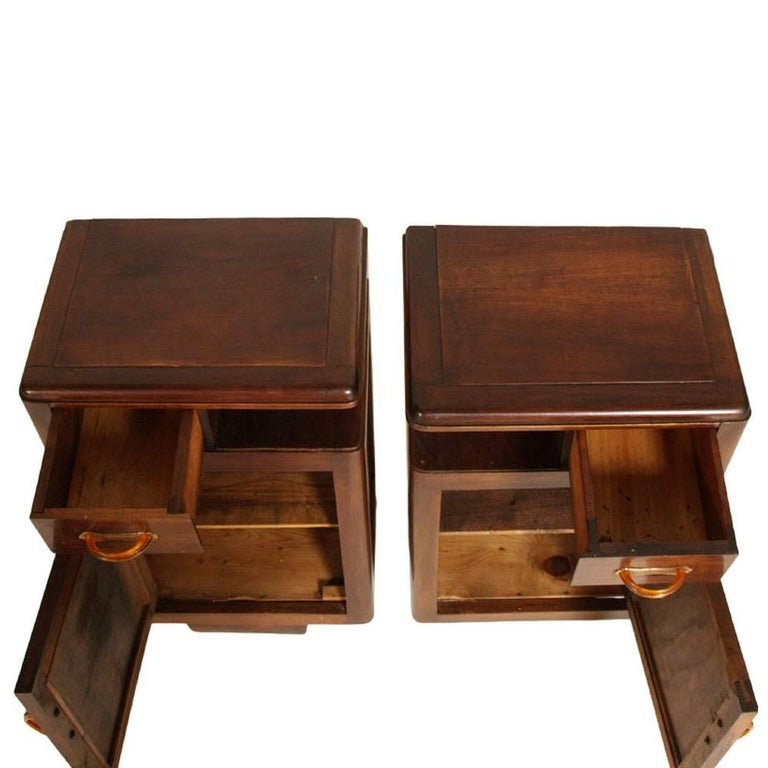1920s Art Deco bedside tables nightstands in walnut restored and polished to wax original handles in bakelite Measures cm: H 73, W 42, D 30.