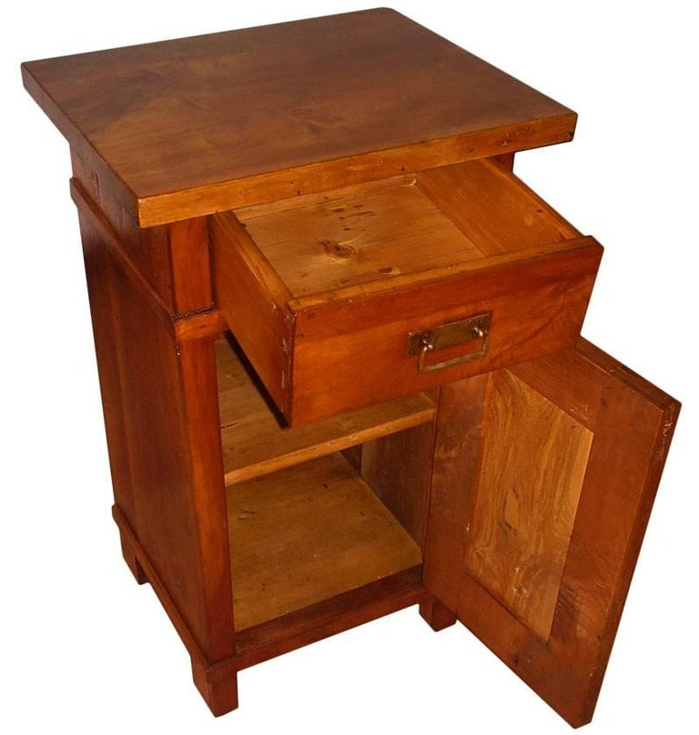 1890s country bedside table, nightstand, period Art Nouveau, in solid cherrywood, restored and polished to wax Measures cm: H 75, W 45, D 36.