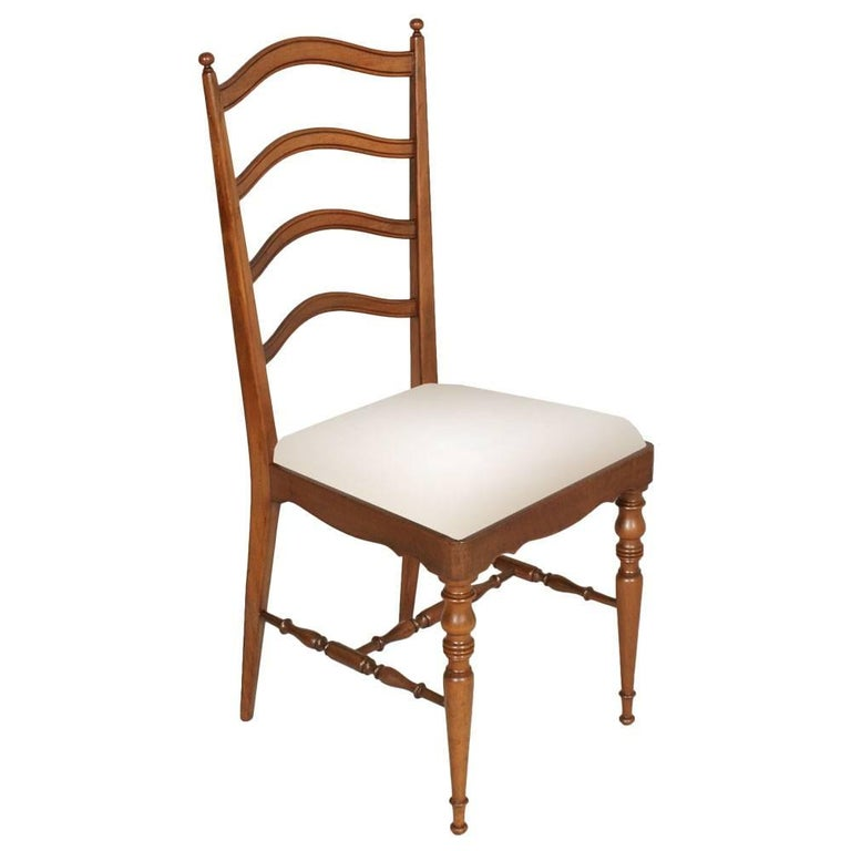 Elegant and robust set of four Mid-Century modern dining Chiavari chairs, in blond walnut with new white upholstery . Manufactured in the city of Chiavari on the Ligurian coast of Italy, created, circa 1960s. Excellent conditions Measure cm: H