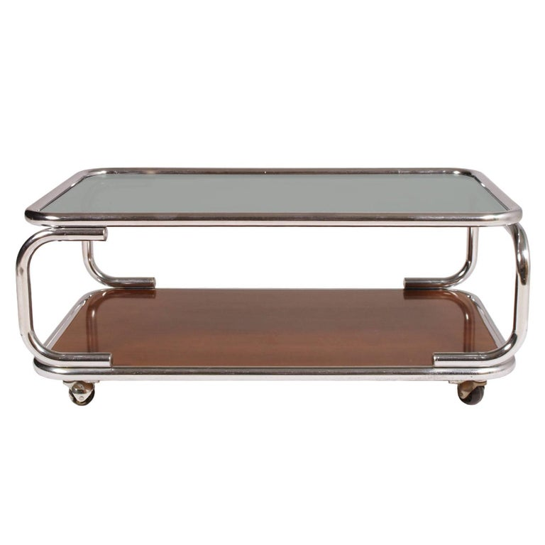 Mid-Century Modern Italy chrome serving trolley or coffee table, with smoked glass top with under faux laminated wood.