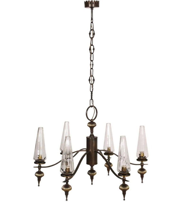 Midcentury Art Deco six-light chandelier in burnished brass and Murano blown glass  Electrical system redone and working  Measures cm: Height 95, diameter 60.