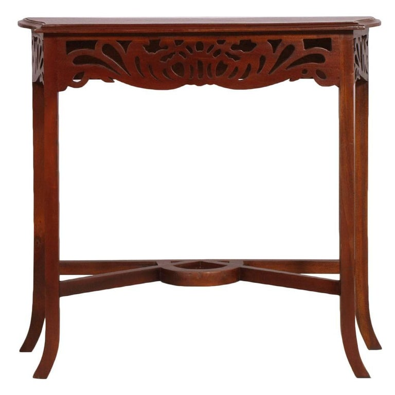 Eugenio Quarti Style 1910s Art Nouveau Belle Époque console in carved walnut polished to wax. The style of this console is Eugenio Quarti (1867-1929) - Italian furniture and cabinet maker in the Stile Liberty (Art Nouveau Style). Quarti Worked