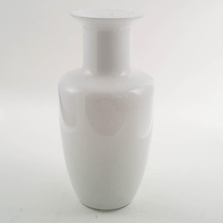 Mid-Century Modern Murano vase, Tapio Wirkkala for Venini attributable, lattimo Murano glass decorated  About: Designed in 1968 by Tapio Wirkkala, these bottles are from the forms gently curved glass (lattimo Murano glass) decorated externally