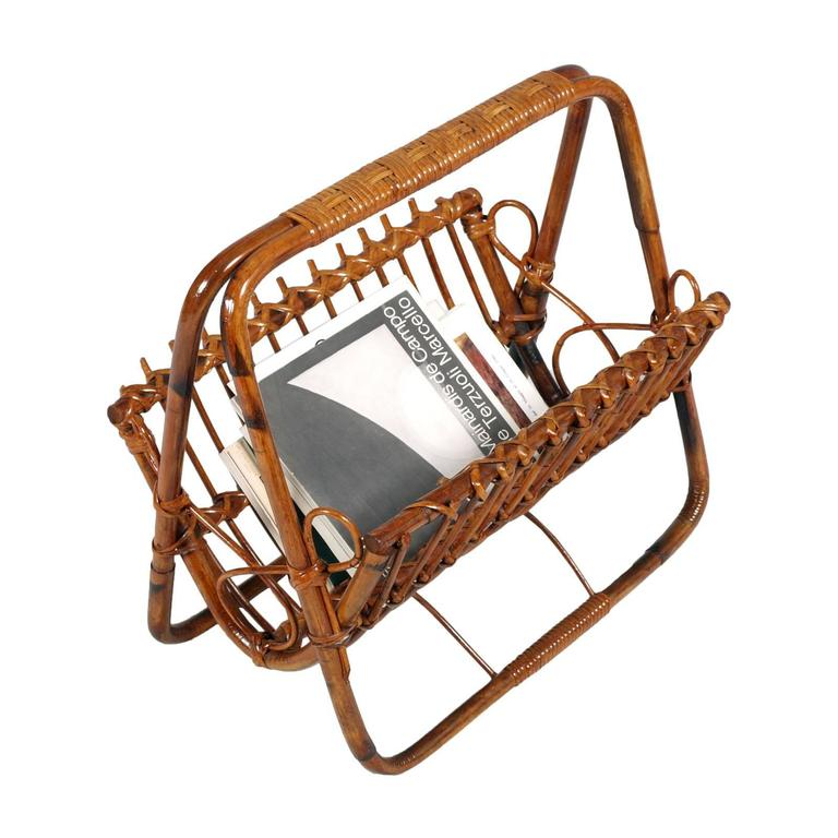 Midcentury bamboo and rattan magazine rack, Franco Albini manner. Polished shellac    Measures cm: D 32, W 50, H 47.