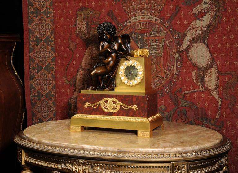 French Early and Fine Bronze, Ormolu and Specimen Marble Clock with Cupid For Sale