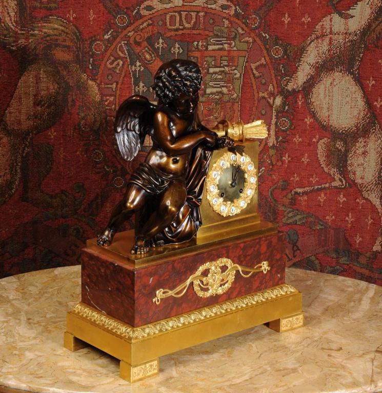 Patinated Early and Fine Bronze, Ormolu and Specimen Marble Clock with Cupid For Sale