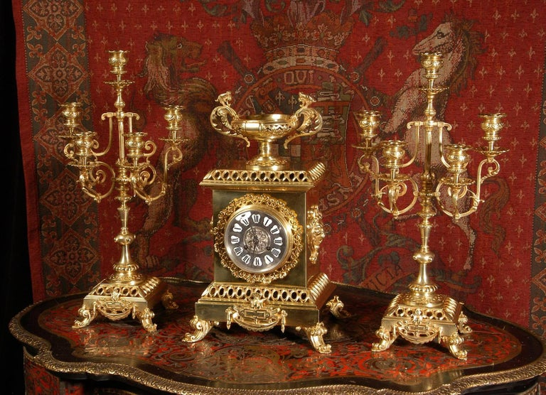 A stunning original gilt bronze clock set by the famous bronze foundry