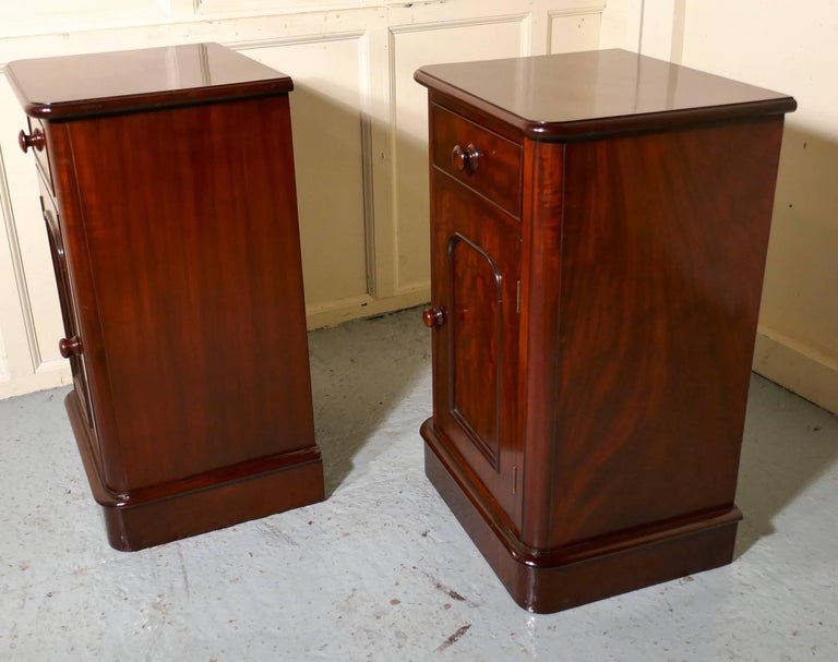 A pair of Victorian mahogany bedside cupboards  These are very good quality cabinets they are made in flame mahogany, each one has a drawer and a shelved cupboard beneath, they are true pair as the doors open in opposite directions. The cabinets