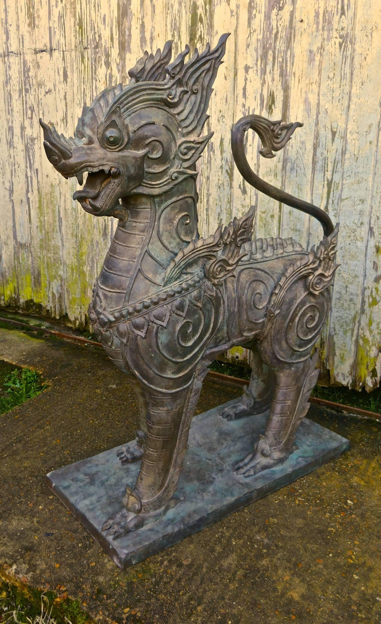 A pair of large bronze Thai temple guardian foo lion dogs  These are a very impressive pair of Singha, guardians of the Buddhist temple in Thailand, the dogs are made in bronze and are very heavy. The dogs stand on a bronze plinth, the detail of