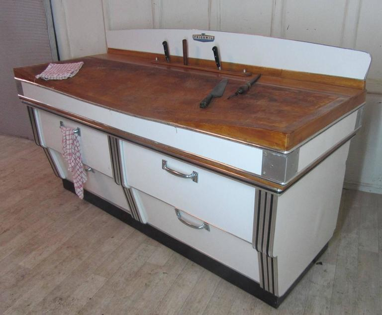 This iconic piece was removed from a Belgian Butchers shop a few months ago, it has been preserved in its original condition The Block is maple, the stand has a waterfall shape, it is in white and steel, it has two deep drawers and two large