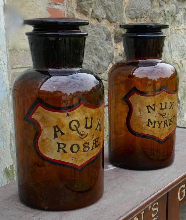 These very attractive jars they date from, circa 1900, one has Aqua Rosæ written on it, the other has Nux Myrist, the writing is set on gold in a shield shape The Jars are in very good condition, they have minor chipping to the interior of the