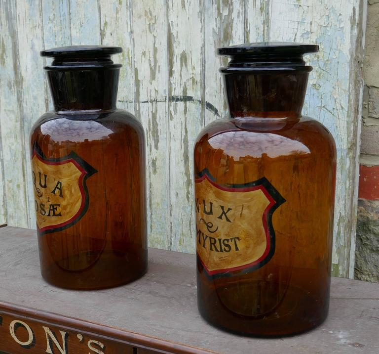 Hand-Crafted Pair of Very Large Amber Glass Chemist Jars, Large Stoppers