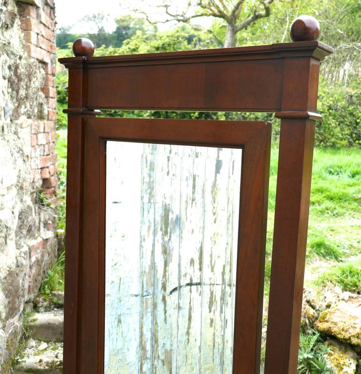 A large 19th century walnut cheval mirror, gentlemans outfitter