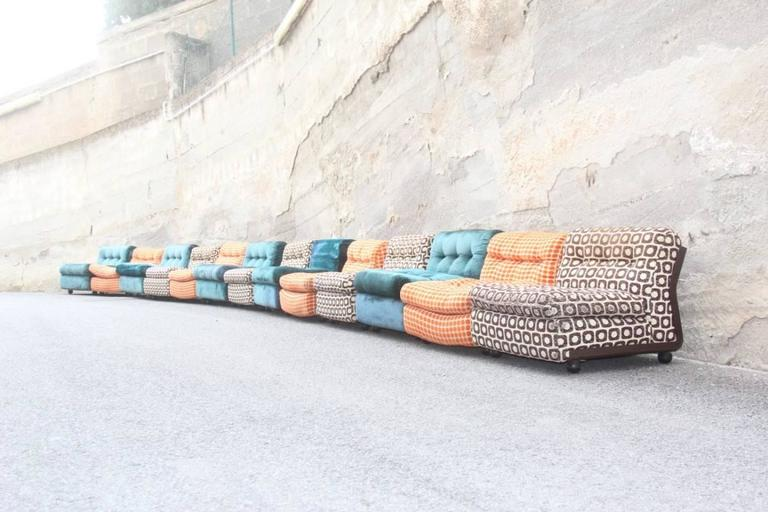 Large sofa with 13 armchairs B&B, Italy, Mario Bellini multicolor, resin shell and multicolored fabric, are then used as such for wear tracks like some scratches and fabrics used.