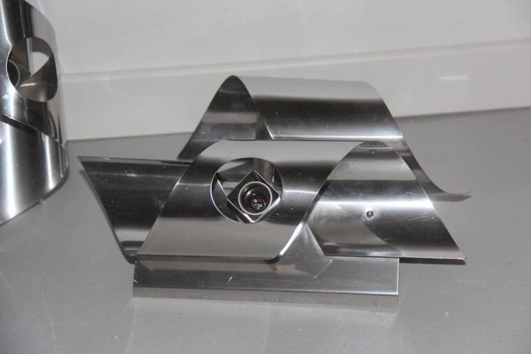 Sculpture steel curved sconces 1970s Italian design.