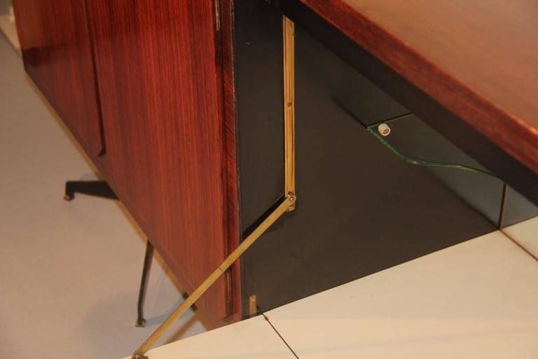 Elegant sideboard Italian Mid-Century design, rosewood wood. Handle with sculpture.