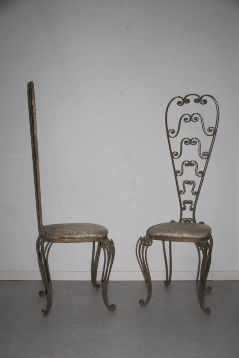 Pair of high backrest metal chairs by Pier Luigi Colli 1950s, Italian design, entirely hand-molded, as if they were sculptures, amazing work of great craftsmanship.