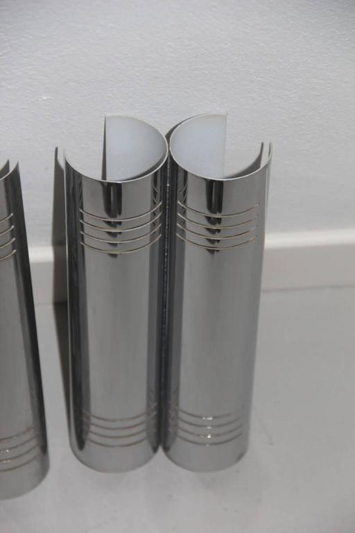 Minimal wall sconces steel curved, 1970s.