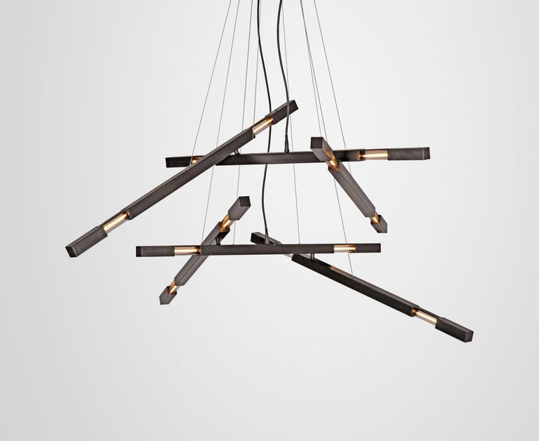 Large three-branch Dynamic Stilk chandelier in brass.