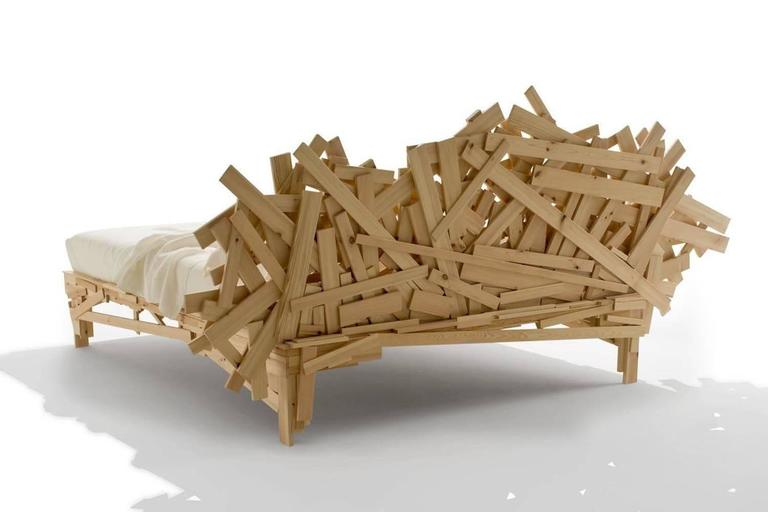 Structurally realized with pine strips of various sizes, manually joined and nailed on one another in a deliberately random fashion. The realization makes each bed a single piece.  Mattress size 180 x 200 cm.