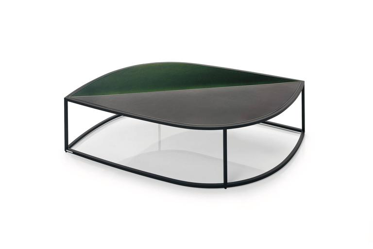 """The Leaf side table extends the Roda outdoor complements proposal, playing in an innovative nature: extra large leaf-shaped side tables designed to coordinate with each other in a harmonious play of """"all green"""" tops. The structure in smoke or milk"""