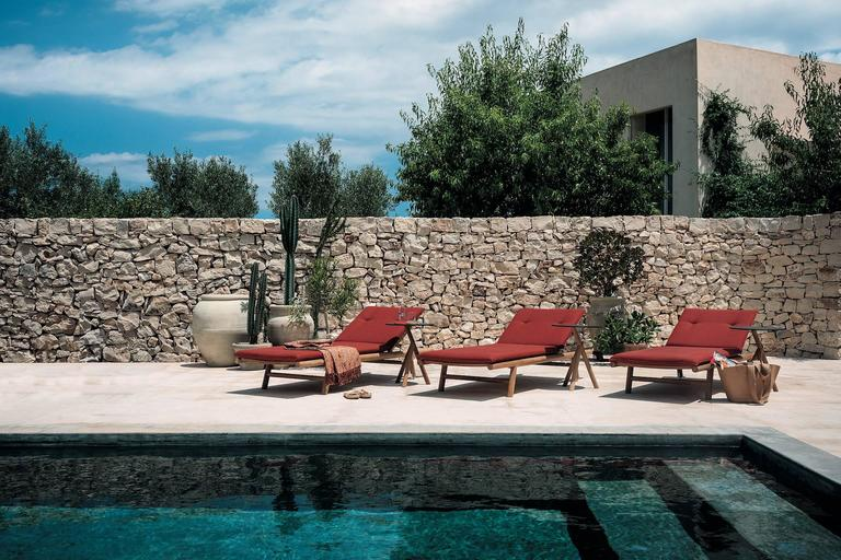 "Orson sunlounger is the the synthesis of classic and contemporary. The harmonic and sinuous lines are the ""fil rouge"" between the items of this collection. Completely made in teak, it seems to have a simple design grammar, but conceals ingenious"